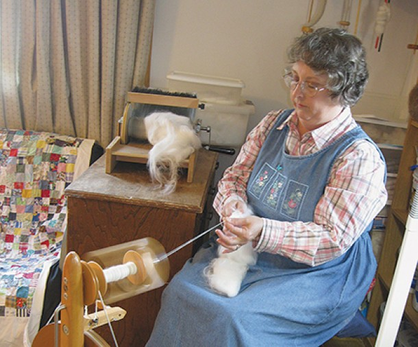 Lisa spins one-ply angora yarn on the spinning wheel.